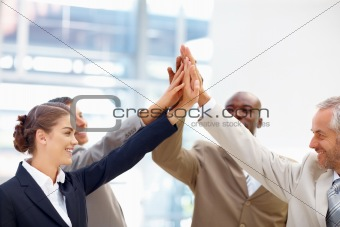 Team of business people with their hands together in unity