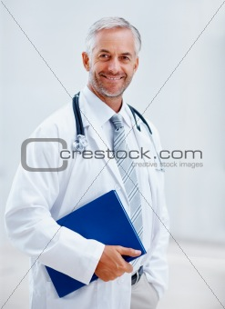 Portrait of a happy mature doctor smiling