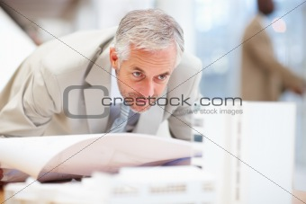 Architect working on building plan