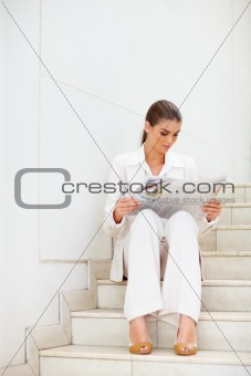 Portrait of a pretty young business woman holding blank bill board