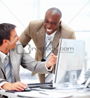 Closeup of successful businesspeople enjoying while working in the office