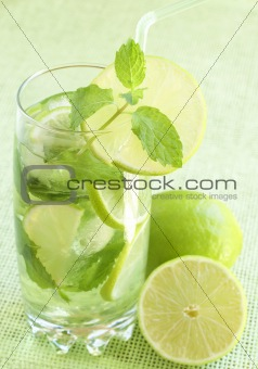Mojito cocktail on green background
