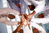 Business people with their hands coming together in unity