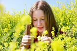 young girl with long hair in yellow flowers