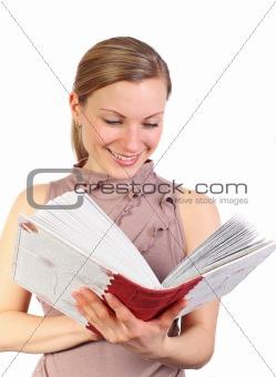 blonde female watching her photo album