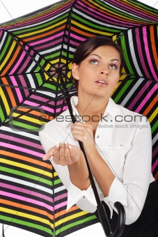 beautiful woman with colourful umbrella on white background