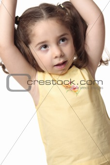 Toddler girl arms above head