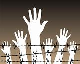 hands behind a barbed wire prison