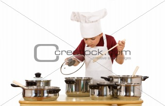 Little chef checking the food