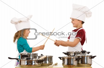 Chefs dual with wooden utensils