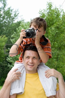 Father and son taking a picture