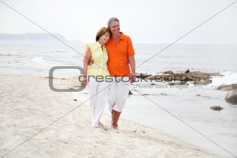 beautiful mature couple on the beach