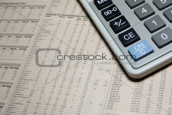 Calculator corner and financial newspaper.