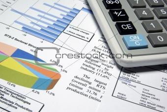 Calculator and printed diagrams.