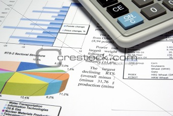Calculator and finance diagrams.