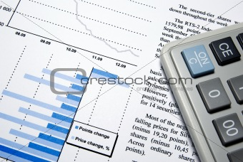 Calculator and printed financial report.