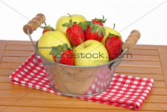 Bowl of strawberries and apples