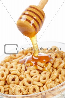 Pouring honey on cornflakes