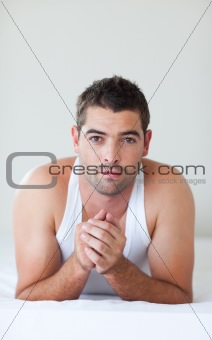 Attractive man lying in bed