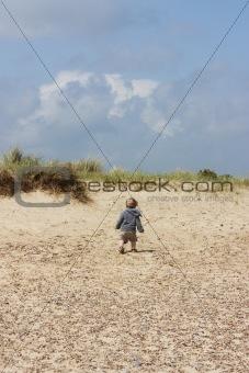 small child on dunes
