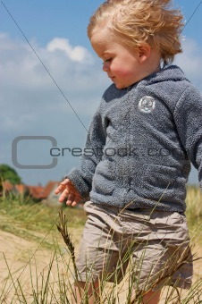 close up of boy in dunes