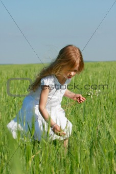 adorable girl with flowers outdoors