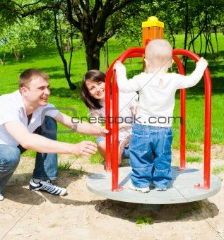 Parents rotating merrygoround