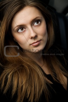 Portrait of beautiful young woman with long hair