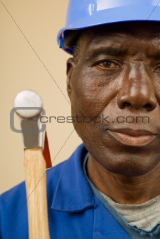 Construction worker holding hammer