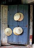 rice picker hats on blue door