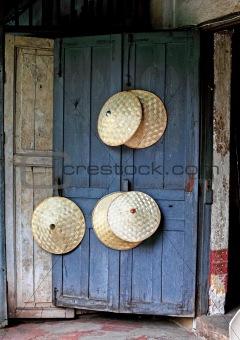 rice picker hats on blue door