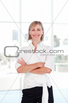 Blonde businesswoman with folded arms