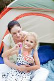 Mother and daughter together in tent