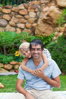 Father giving daughter piggyback