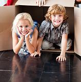 Children having fun in their new house