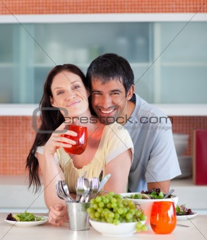 Couple eating and drinking in the kitchen