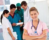 Nurse with doctors in the background