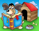 Dog with book in front of kennel