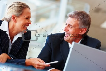 Business woman in discussion with a colleague