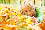 Girl lying in leaves