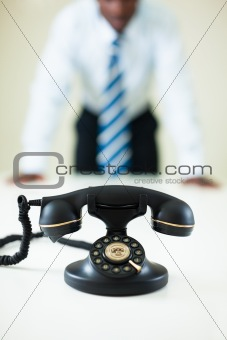 businessman staring at the phone
