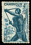 Vintage stamp from Cameroon depicting a tribal hunter