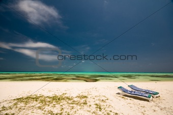 chairs on a tropical beach