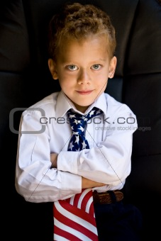 A portrait of young boy wearing US flag necktie