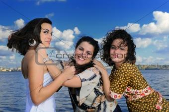 Three girls posing