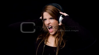 portrait of shouting woman listening music