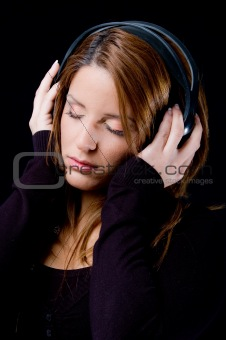 portrait of young woman enjoying music