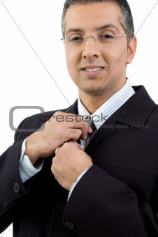 portrait of ceo holding his tie