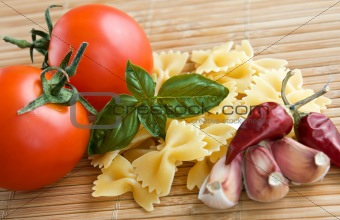 Tomatoes with raw pasta