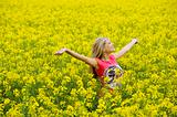 happy girl in yellow field